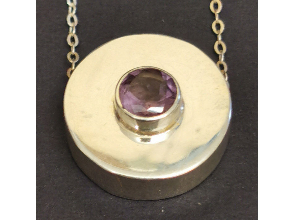 Silver pendant set with an amethyst facet stone